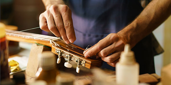 Artisan Lute Maker Fixing Stringed Instrument Replacing Guitar String